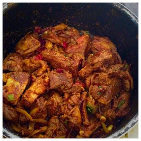 The marinated goat meat is steamed on low heat to release its natural juices.
